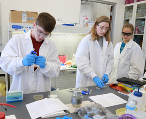 Three students in a lab