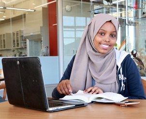 Smiling student studying in science center