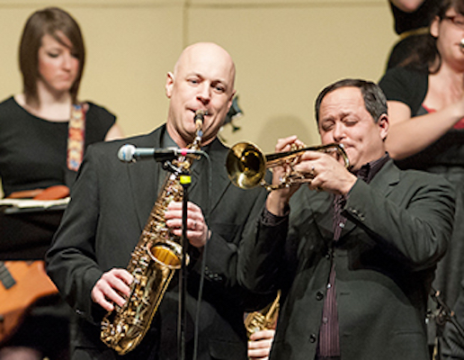 Jazz musicians perform on saxophone and trumpet