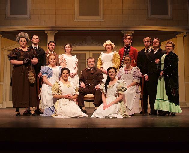 Musical cast pose for photo