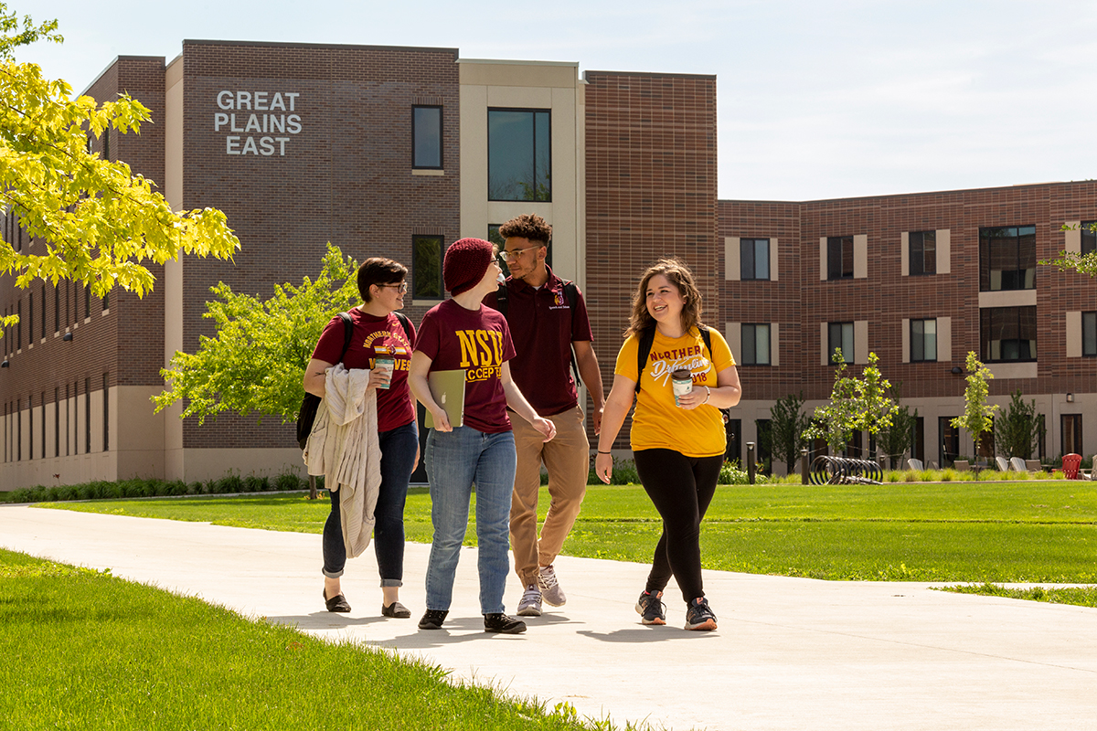 A group of students strolls campus near Great Plains East