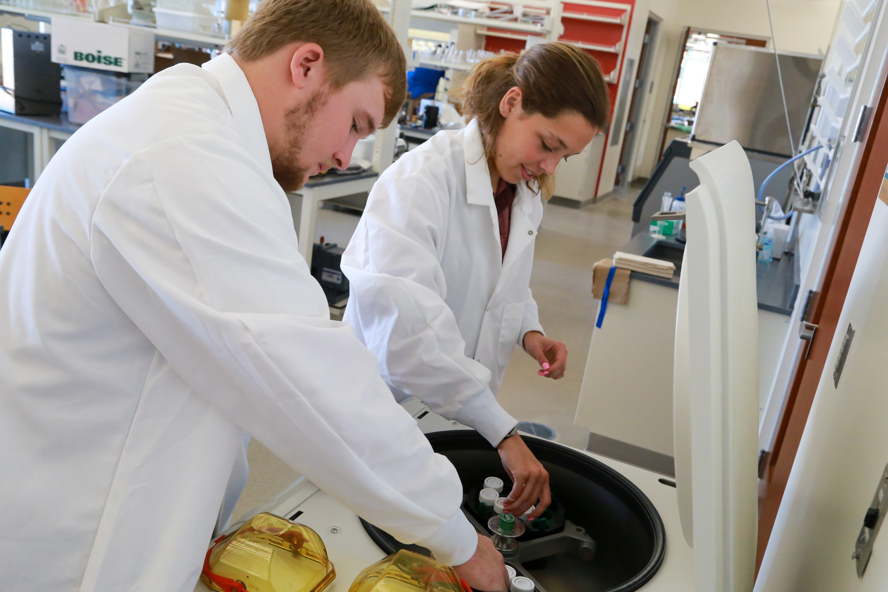 Two students working in the Jewett Regional Science Education Center.