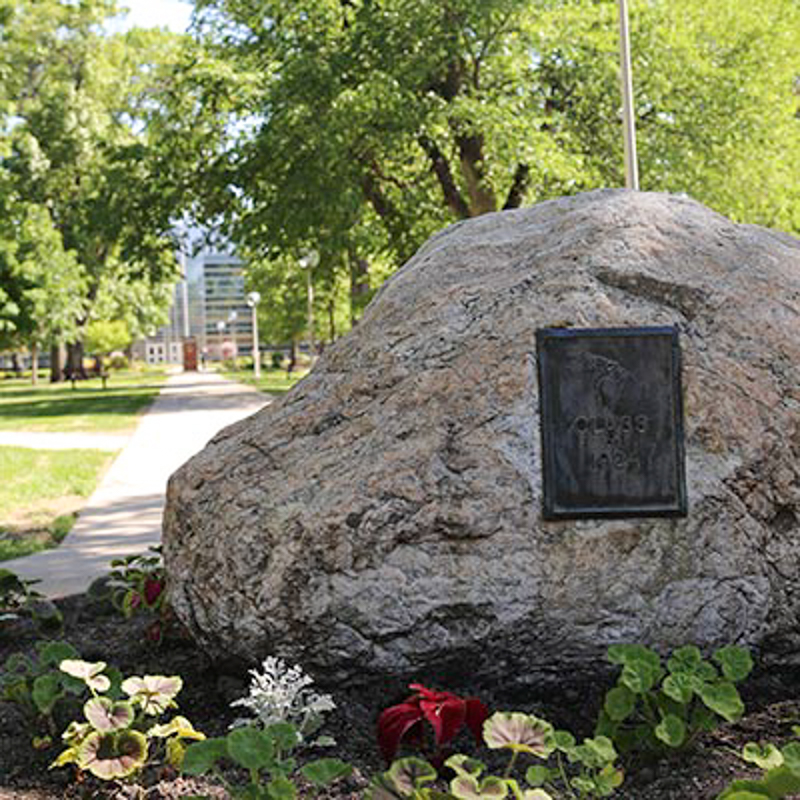 Large rock monument at north campus entrance