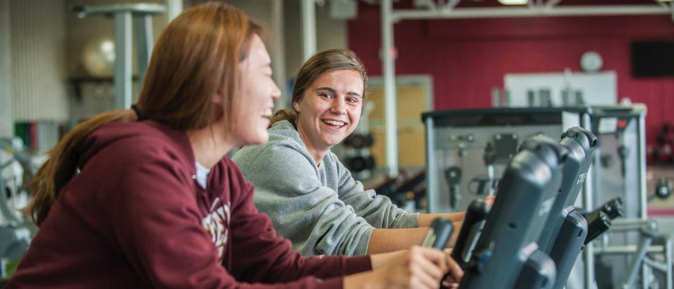 Two students working out in fitness center