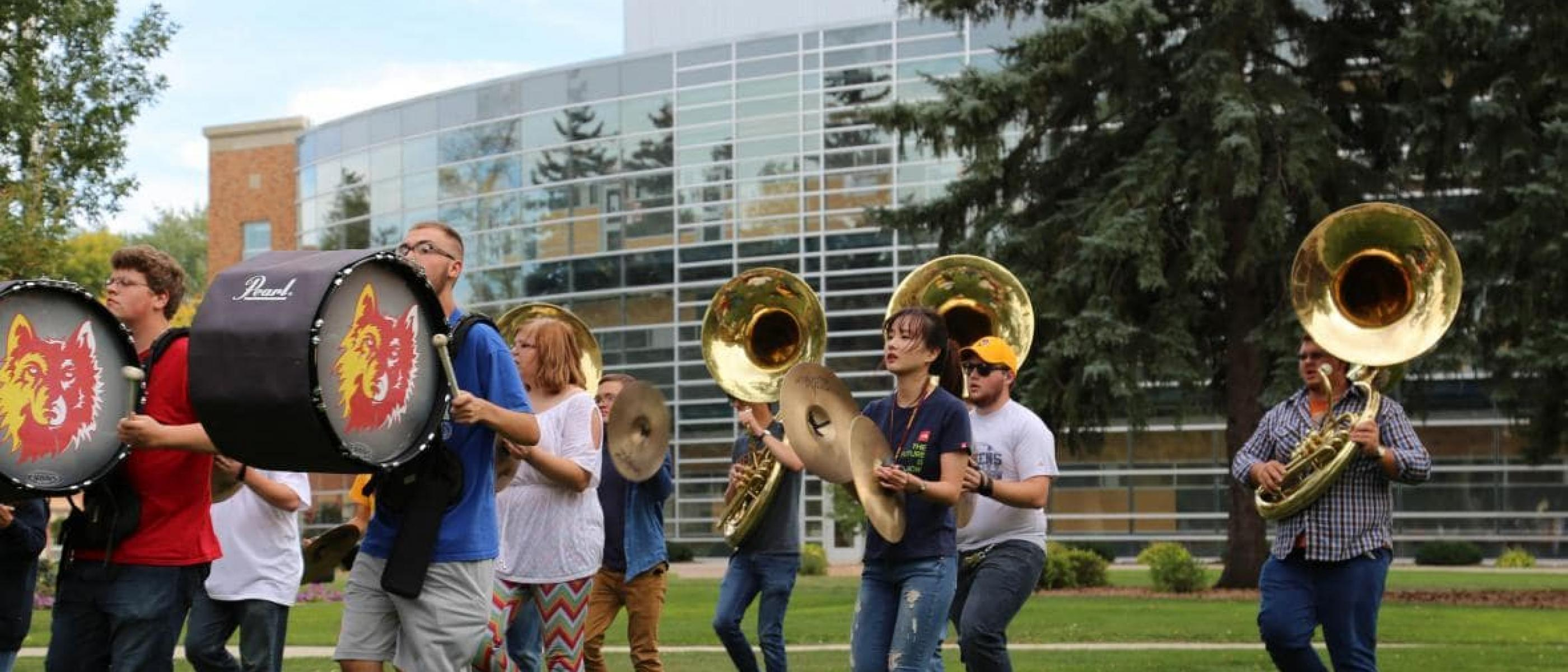 Members of the Marching Wolves practice on the campus green.