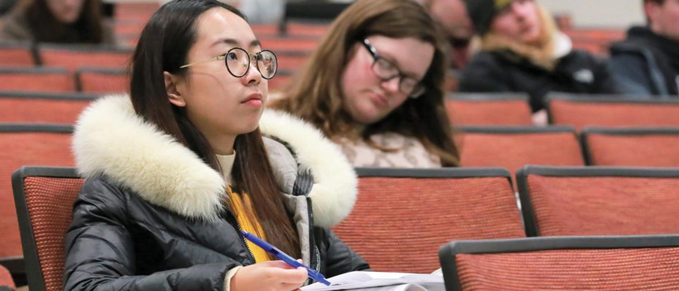 Student listening during classroom lecture