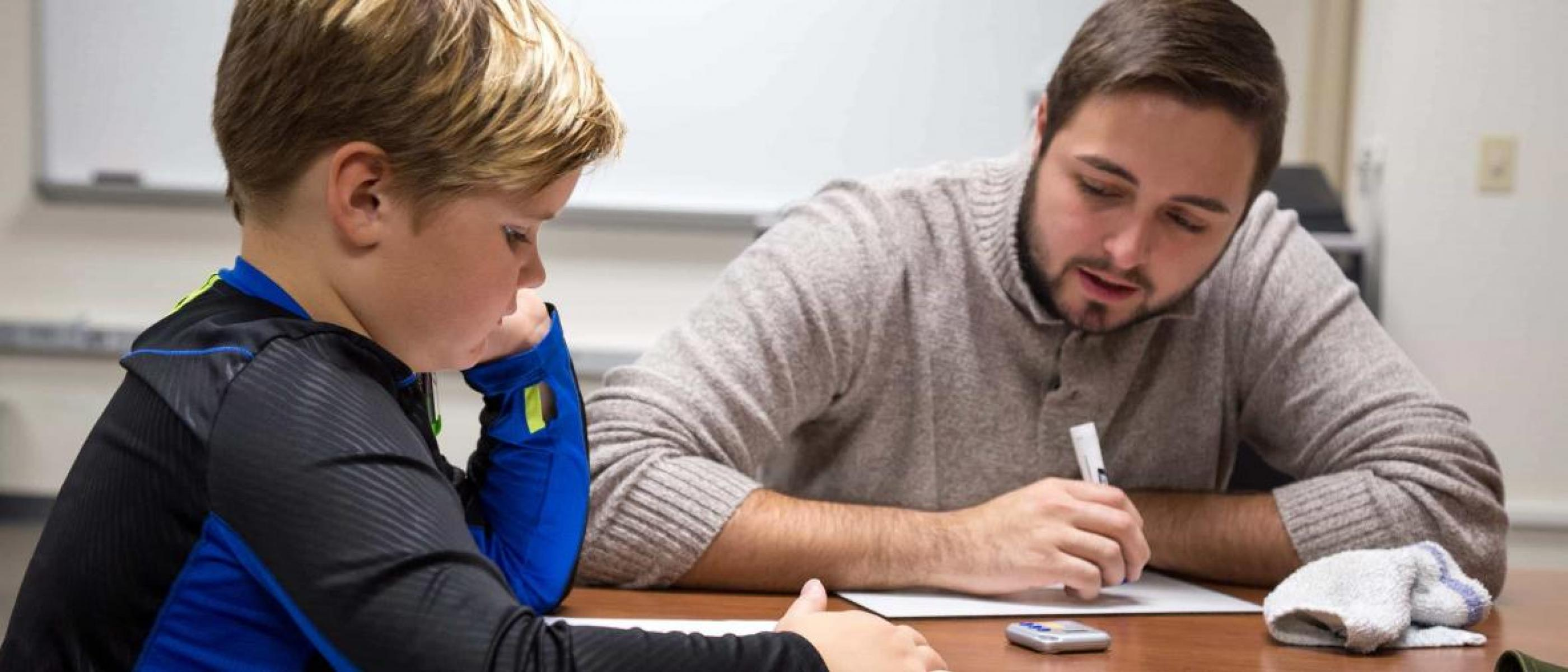 A student and tutor work in the NSU Reading Clinic.
