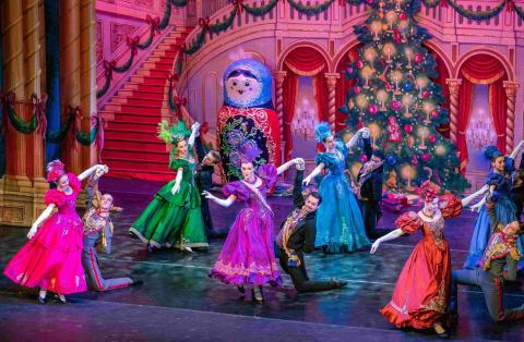 Nutcracker dancers performing on stage in colorful costumes