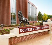 Wolf statue in front of Jewett Regional Science Education Center