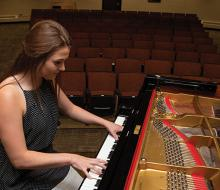 Student playing the piano