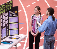 Student presenting at science fair