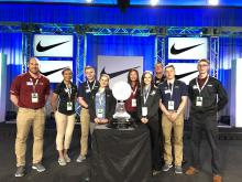 Professor and students at Final Four