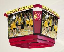 Image of scoreboard displaying photo of volleyball players