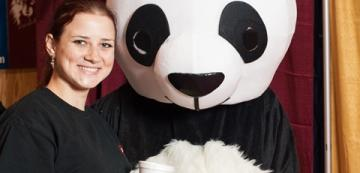 Girl poses for selfie with Chinese panda