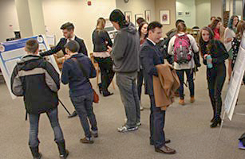 People examine research posters